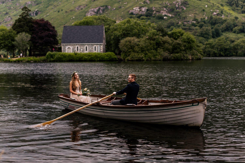 Gougane barra wedding couple on lake in rowboat