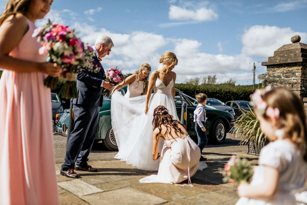 Bride arriving at church with bridemaids for west cork wedding