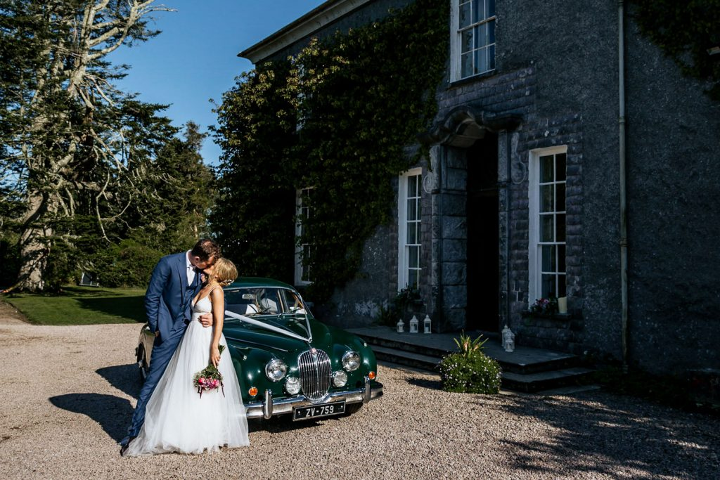 West cork wedding venue Drishane house couple car