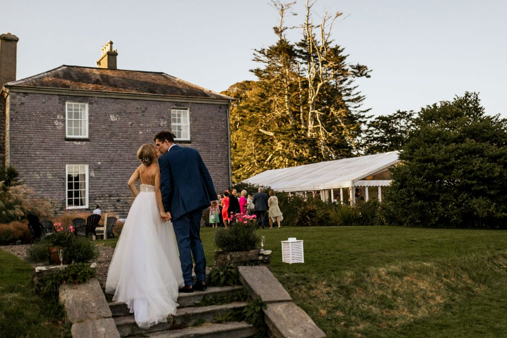 west cork wedding couple kissing at venue drishane house