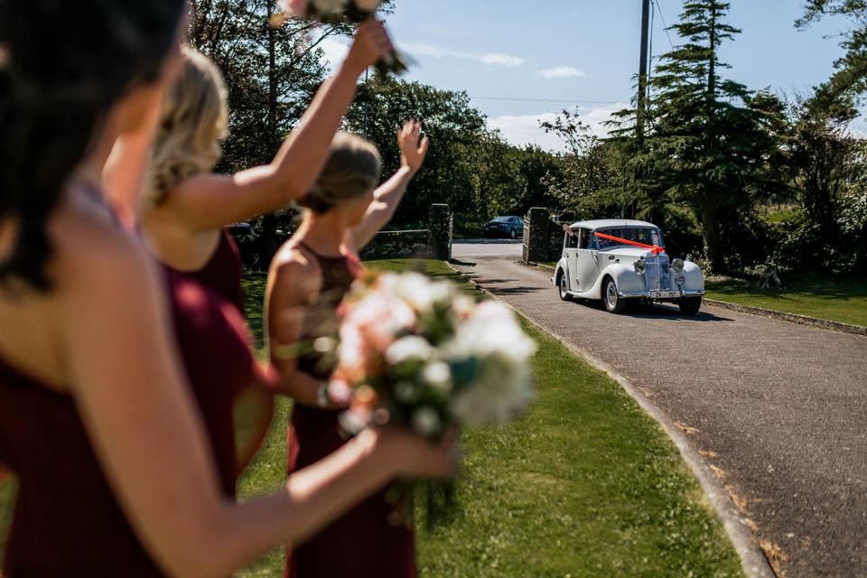 west cork wedding bride arriving vintage car