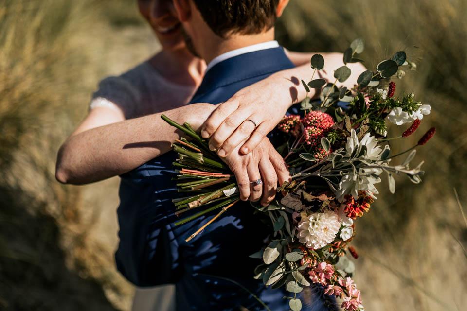 Inchydoney beach wedding portrait bride bouquet