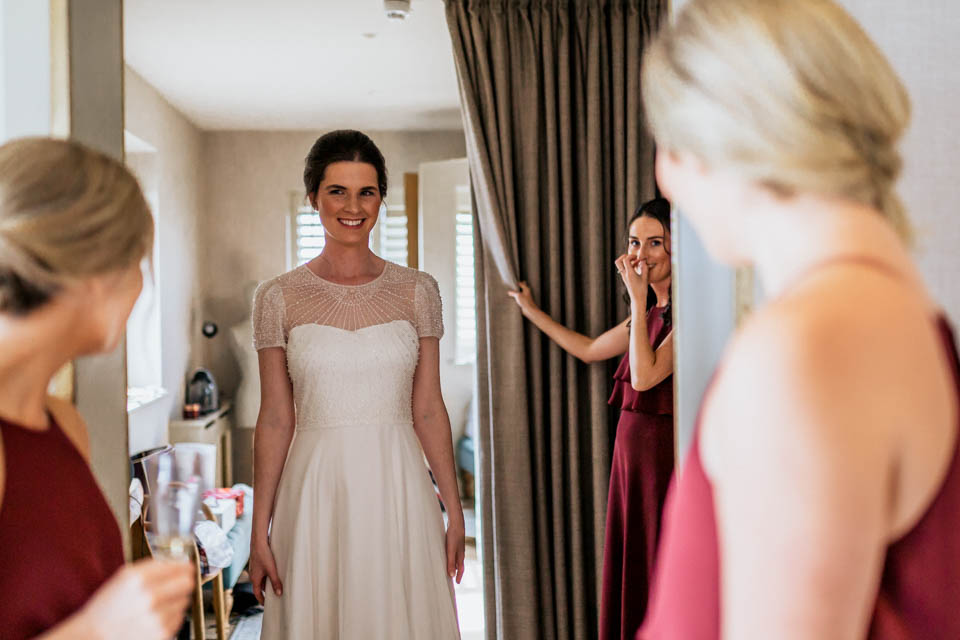 Plan Your Wedding Day Timeline to make sure you're in your dress on time.