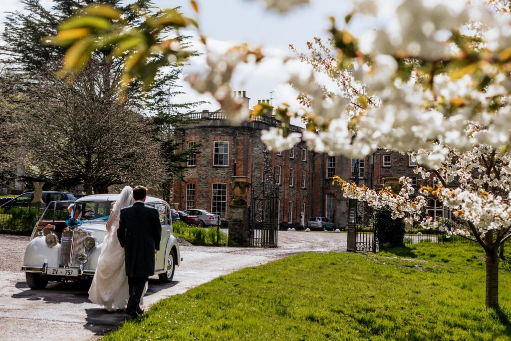 wedding couple with vintage car at bantry House