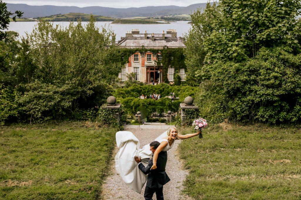 Bantry House groom lifting bride