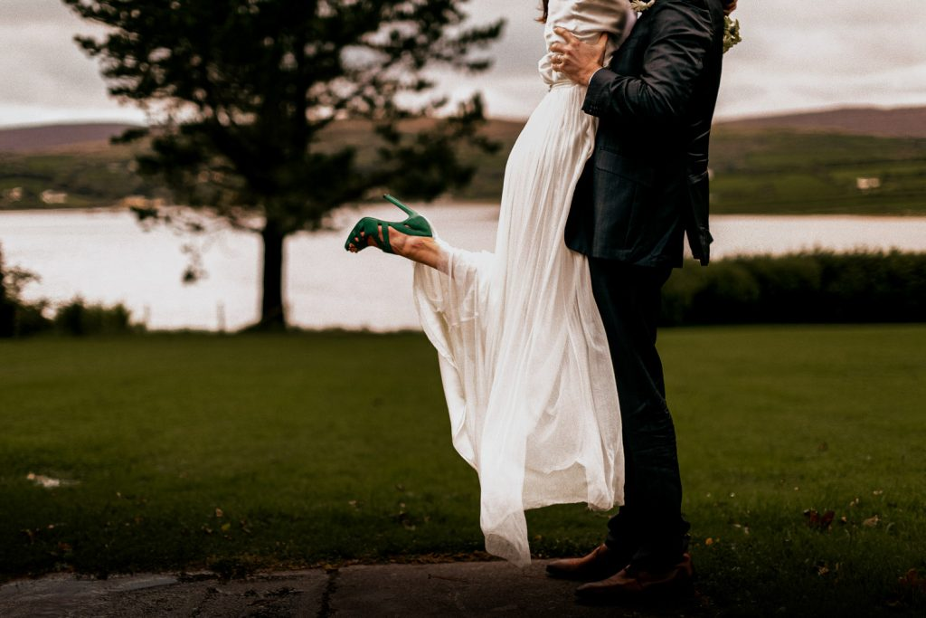 Groom lifting bride green shoes Blairscove house