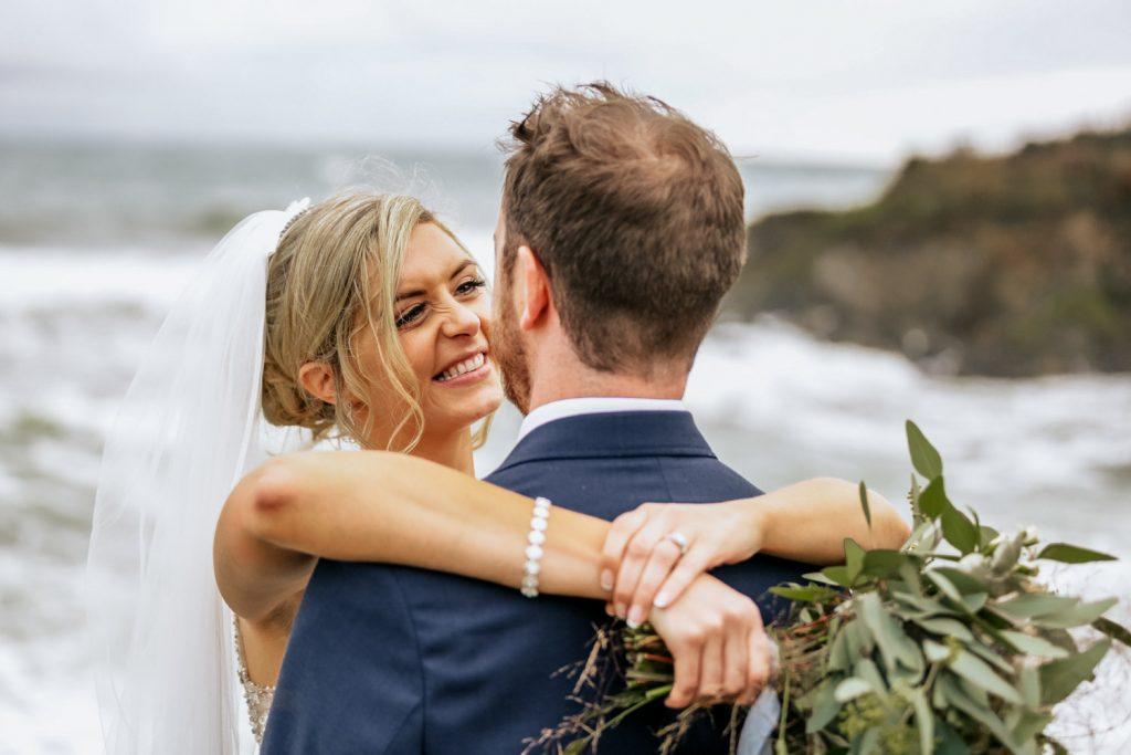 happy wedding couple on cliffs