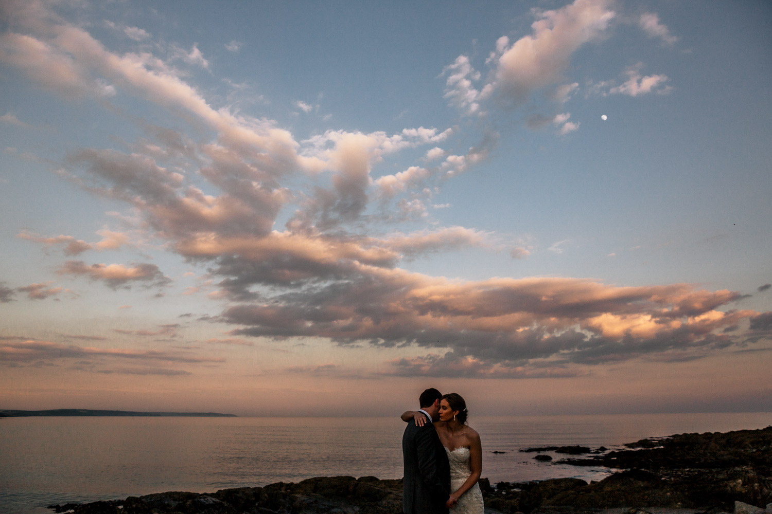 Wedding couple sunset at Dunmore cove