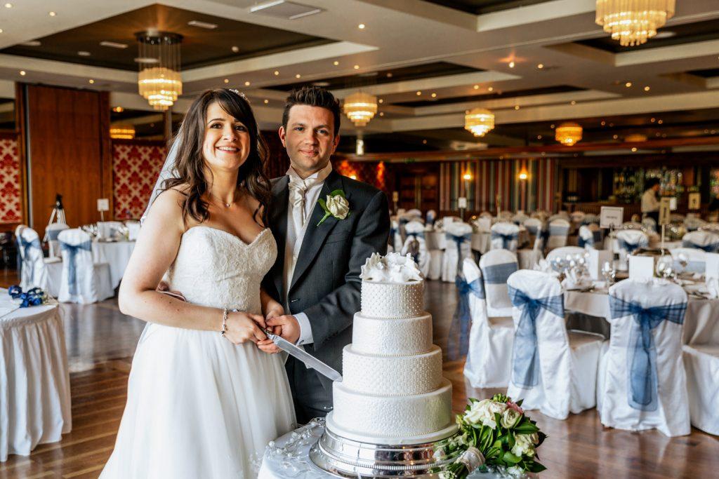 Maritime hotel wedding couple and cake