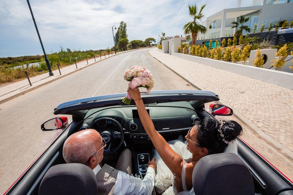 Convertible car with wedding couple